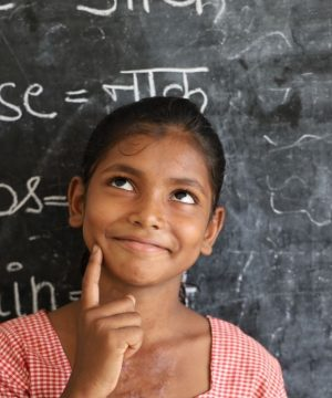 A beautiful girl standing in front of the blackboard